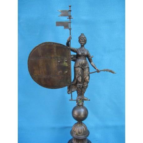 Giraldillo en bronce cincelado y patinado de 35 cm.